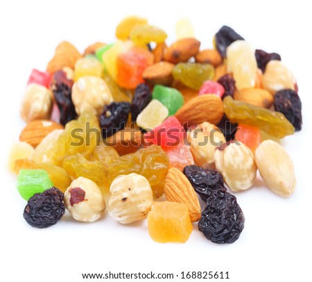 Assorted nuts and candied fruit on a white background - stock photo