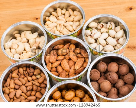 Assorted nuts in Iron pot (pecan, pistachios, almond, peanut, cashew,Pine nuts?