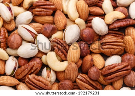 Assorted nuts. Nuts mix. Heap of nuts. Nuts seeds. Mixed nuts. Hazelnuts. Background texture of assorted nuts including cashew nuts, pecan nuts, almonds. Nuts background. Nuts set. Pile of nuts. - stock photo