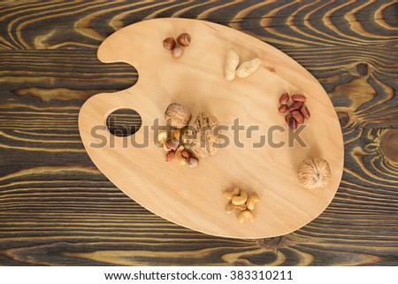 Assorted nuts on the palette - healthy food - stock photo