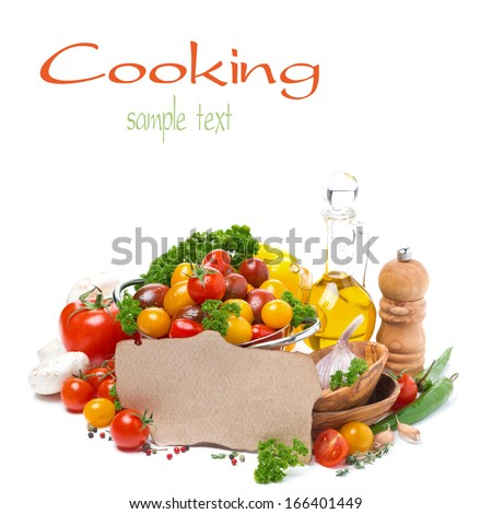 assorted of cherry tomatoes, olive oil, herbs and paper for the recipe, isolated on white