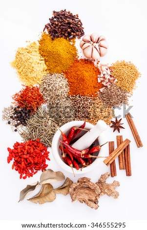 Assorted of spices black pepper ,white pepper,fenugreek,cumin ,bay leaf,cinnamon,thyme,matrimony vine,safflower,rosemary and fennel seeds with white mortar isolated on white background. - stock photo