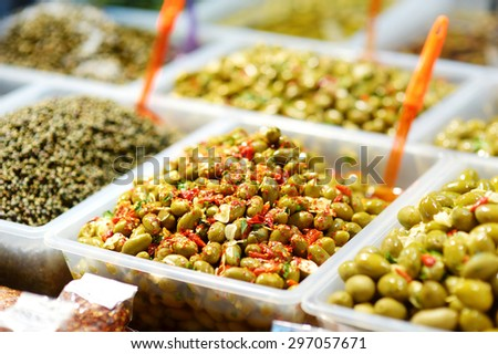 Assorted olives on farmer's market in Italy - stock photo