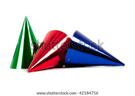 Assorted party hats including red, green, and blue on a white background with copy space - stock photo