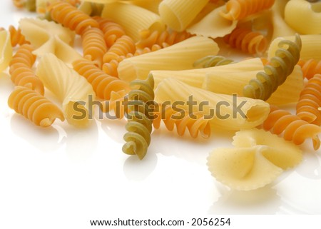 assorted pasta still life over white background
