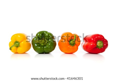 Assorted peppers including yellow, bell, green, orange and red on a white background