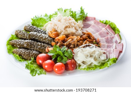Assorted pickles. Appetizer of tomatoes, cucumbers, onions and lettuce - stock photo