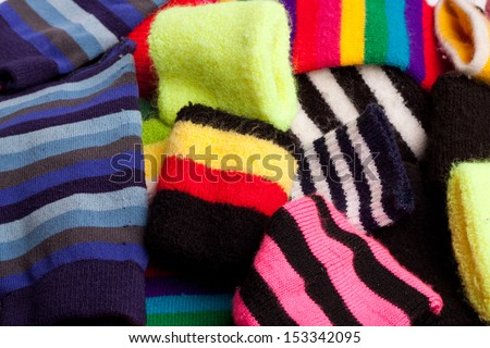 Assorted pile of arm and wrist bands - stock photo