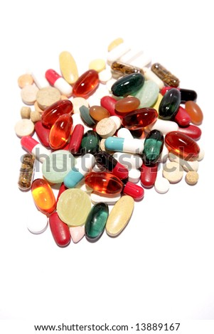 Assorted pills and tablets on white background