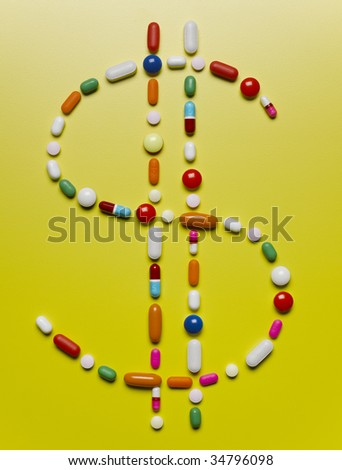 Assorted pills creating dollar symbol - stock photo