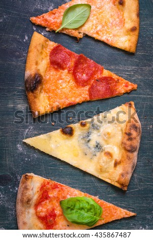 Assorted Pizza Slices. Margherita, Pepperoni, Four Cheese Pizza. Top View.  Different