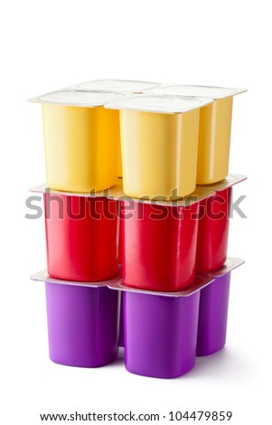 Assorted plastic containers for dairy products with foil lid. Isolated on a white. - stock photo