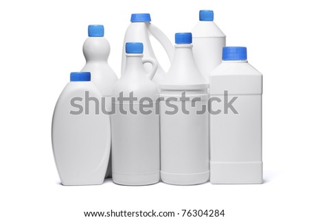 Assorted plastic containers for household detergents on white background - stock photo