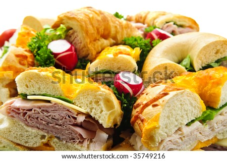 Assorted platter of sandwiches with meat and vegetables - stock photo