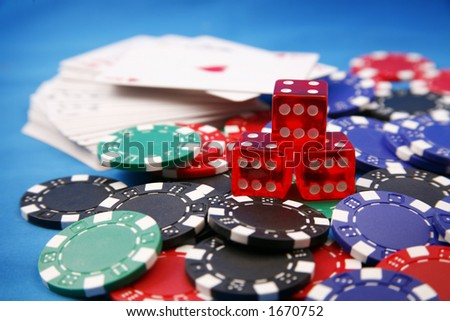 Assorted poker chips, die and cards - stock photo