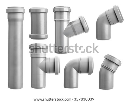 Assorted PVC sewage pipe fittings shot on white - stock photo