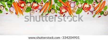 Assorted raw organic vegetables and ingredients for Healthy cooking on white wooden background, top view, banner. Vegetarian and diet food concept. - stock photo