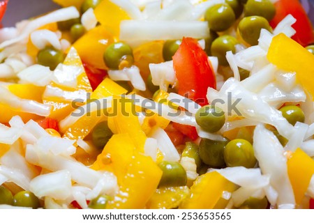 Assorted salad with bell peppers, cabbage, tomatoes and green peas. close up - stock photo