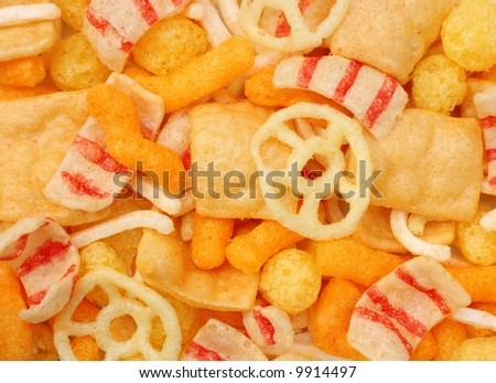 Assorted salted snacks background - stock photo