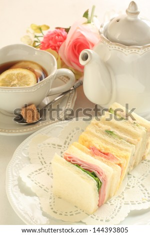 assorted sandwiches in square size on wooden plate with copy space - stock photo