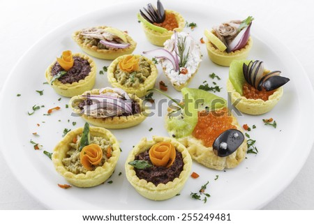 Assorted savory holiday snacks on plate - stock photo