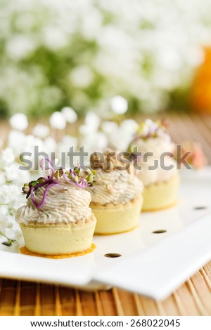 Assorted savoury holiday snacks on plate - stock photo