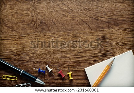 Assorted School or Office Supplies on Top of Wooden Worktable with Copy-space Above. Captured on High Angle. - stock photo