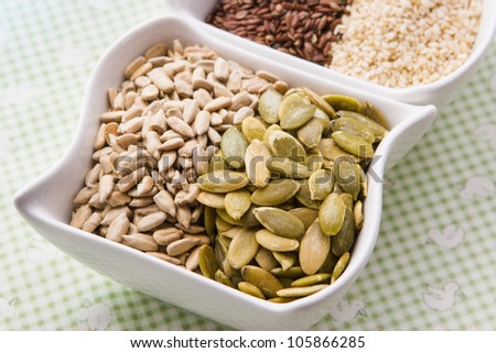 Assorted seeds pumpkin, sunflower, sesame, flax - stock photo