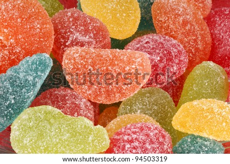 Assorted shaped and flavored fruit jellies background