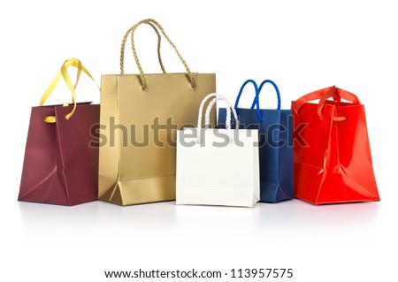 Assorted  shopping bags including red, gold, blue  on a white background - stock photo