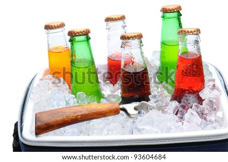 Assorted soda bottles in a cooler full of ice with bottle opener. Horizontal format over white. - stock photo