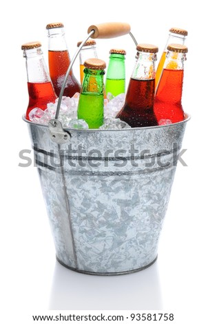 Assorted soda bottles in a metal bucket full of ice. Vertical format over white with reflection - stock photo