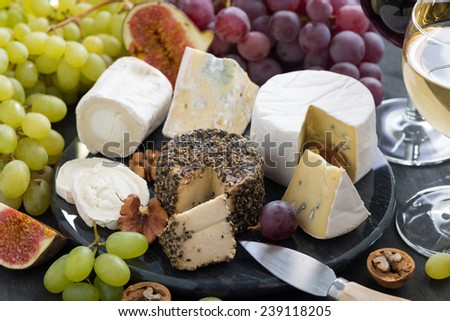 Assorted soft delicacy cheeses and appetizers to wine, close-up