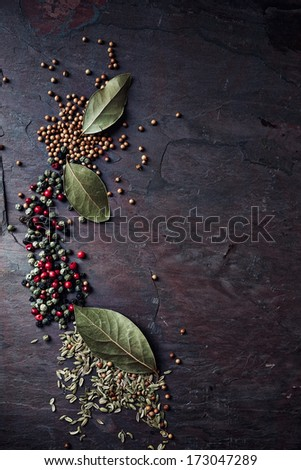 Assorted spices on a stone background - stock photo
