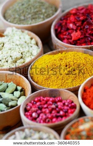 Assorted spices on wooden table