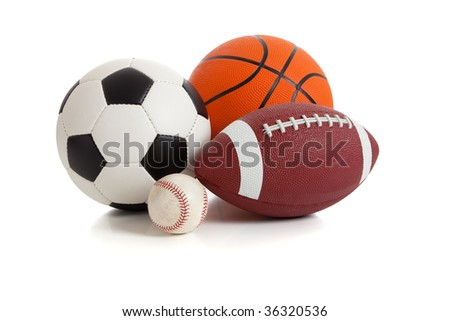 Assorted sports ball on a white background.  Includes a soccer ball, a football, a basketball and a baseball