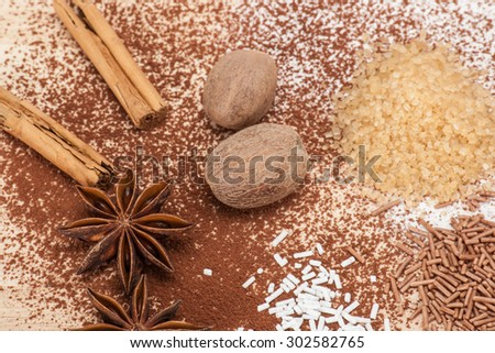 Assorted Sprinkles And Spices On Kitchen Board.