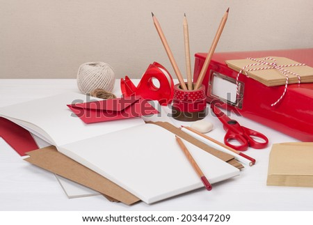 Assorted Stationery Items On Desk - stock photo