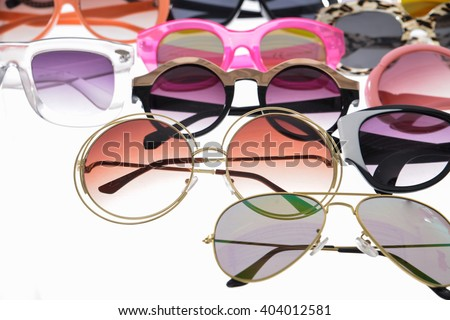 Assorted styles of tinted sunglasses isolated on white background - stock photo