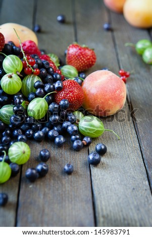 Assorted summer berries on the boards, mix - stock photo