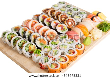 Assorted sushi rolls on a wooden board isolated on white background