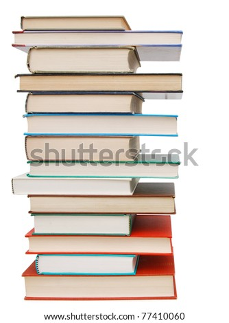 Assorted textbook tower on white