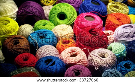Assorted threads of colorful yarn - stock photo