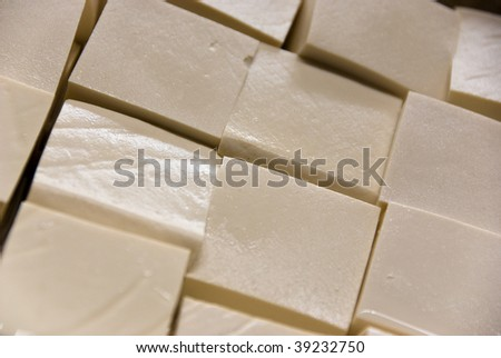 assorted tofu blocks at marketplace - stock photo