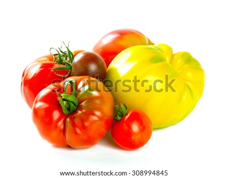 assorted tomatoes isolated on white - stock photo