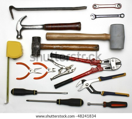 assorted tools on a high-key background - stock photo