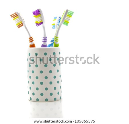 Assorted Tooth Brushes  in holder on white background - stock photo