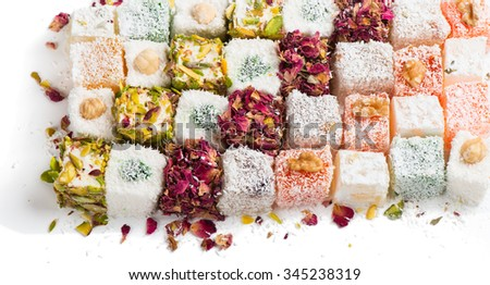 Assorted traditional turkish delight on white background - stock photo