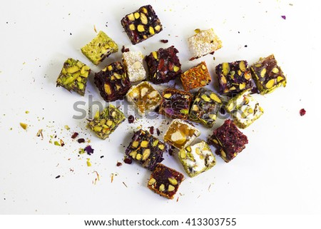 Assorted Turkish Delights on white background. Sugar coated soft candy - stock photo