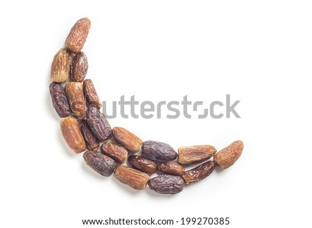 Assorted types of ripped dates arranged in moon shape - stock photo